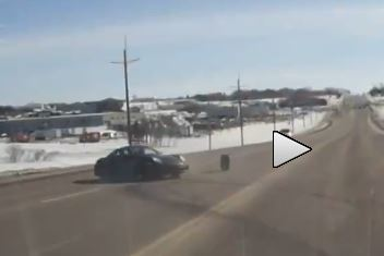 Porsche driver loses traction, then loses a wheel