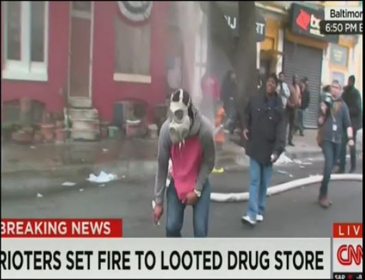 Baltimore rioter cuts fire hose